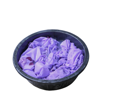 Soak dirty clothes in the basin black for cleansing  isolated on white background and clipping path Banco de Imagens