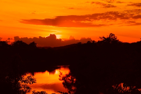 sunset beautiful colorful landscape and silhouette tree water reflexion in sky twilight time Stock Photo