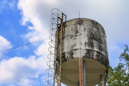 water tank ancient for agriculture on blue sky background