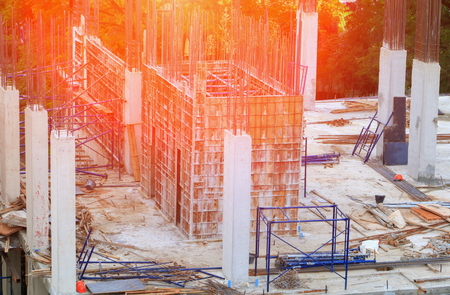 Construction site and building with sunrise light tone. Фото со стока