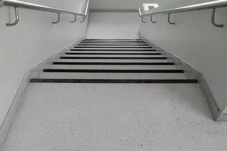 terrazzo floor stairs walkway down. select focus with shallow depth of field. Imagens