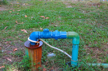 water valve plumbing steel have repair pipes with modify of joined and painted blue on the grass