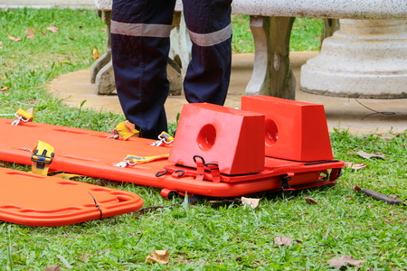 stretcher for emergency paramedic service medical equipment on lawn background Stock Photo