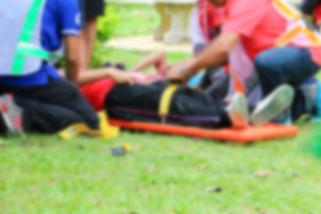 blurred of emergency medical service. Paramedic is pulling stretcher with assist a patient in  rescue situations. Archivio Fotografico
