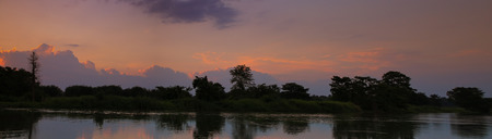 panorama sunset in sky beautiful colorful landscape silhouette tree woodland and river reflect the twilight time Archivio Fotografico