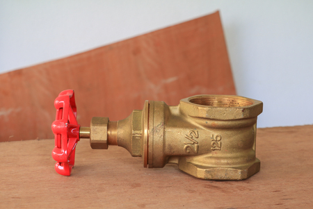 brass valve with red knob in a factory plumber