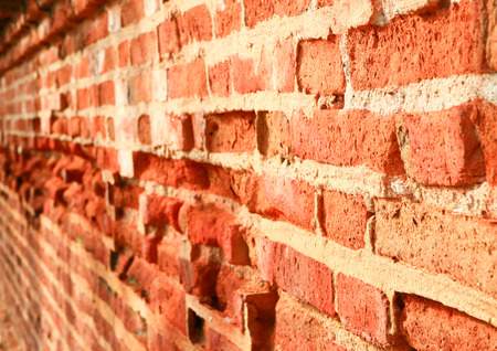 brick wall ancient old orange surface background beautiful select focus with shallow depth of field. Stock Photo