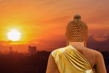 buddha statue on sunset sky and city blur background beautiful Stock fotó