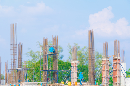 construction workers site and building of housing outdoor. which has sky background with copy space add text