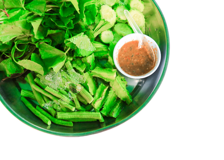Shrimp-paste sauce and fresh vegetables herb in the tray on white background