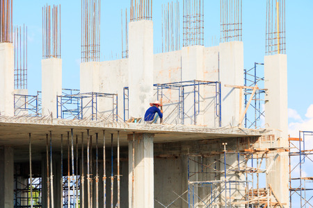 construction workers site and building of housing at laborer work outdoor. which has sky background with copy space add text
