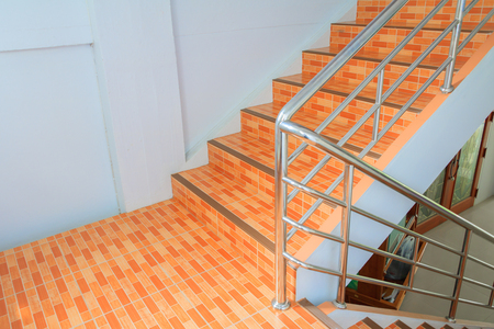 stairs tile orange walkway up. select focus with shallow depth of field