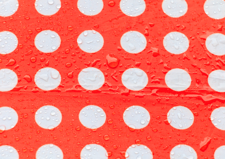 water drop on a waterproof fabric point Red and white beautiful background  with copy space Stok Fotoğraf