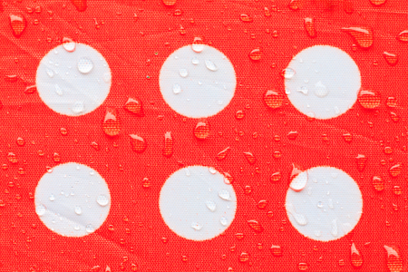water drop on a waterproof fabric point Red and white beautiful background  with copy space Stock fotó