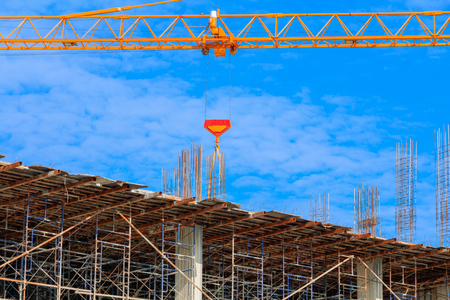 work construction building workplace in develop city and crane on sky background with copy space add text