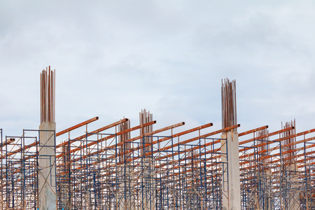 frame post steel in construction workers site and building of housing outdoor. which has storm cloud in sky background with copy space add text 写真素材