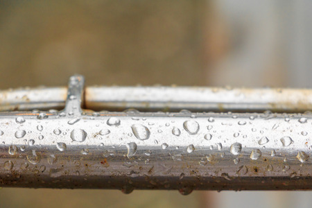 water drops on old metallic steel pipe aluminum background with copy space add text