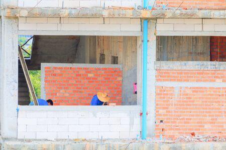 construction workers building develop of housing at laborer work outdoor. Banco de Imagens