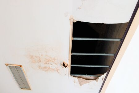 gypsum ceiling inside damaged by water leaking