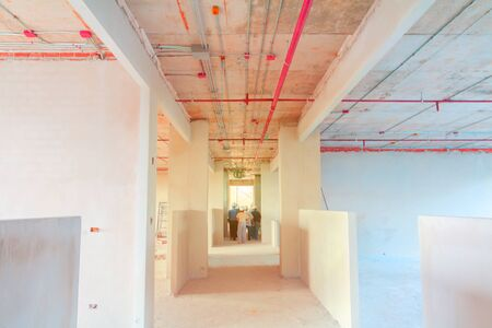 interior in construction and wall decoration at building site with engineer motion and tone light sunlight  morning