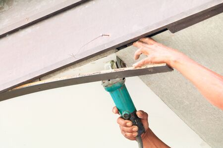 hand technician repairing ceiling with Grinding wheel interior home