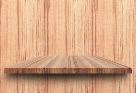 Empty top wooden shelves and woody wall background. For product display with copy space add text