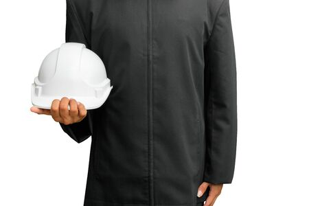 hand of engineering worker holding white safety helmet plastic. equipment prevent danger engineer in construction isolated on white background