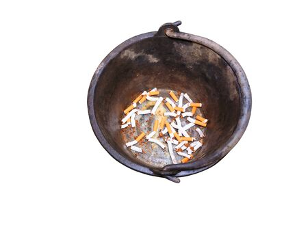Pile cigarettes broken in black bin isolated on white background and clipping path.. health care concept stop quitting smoking.