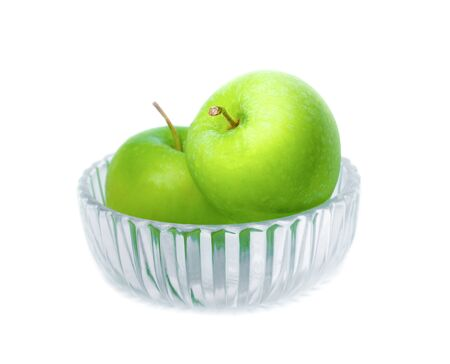 Two Green apple in Glass bowl on white background with water drop, fruit Nourish the health body