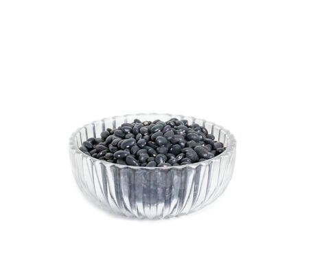 black beans Top view in clear Glass bowl on white background