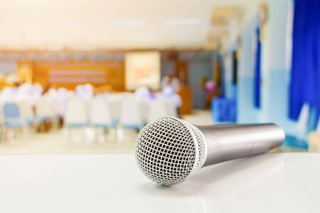 Close up microphone wireless on the table in the conference and Background blur interior seminar meeting room Stock fotó