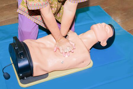 hand student Heart pump with medical dummy on CPR, in emergency refresher training to assist of physician