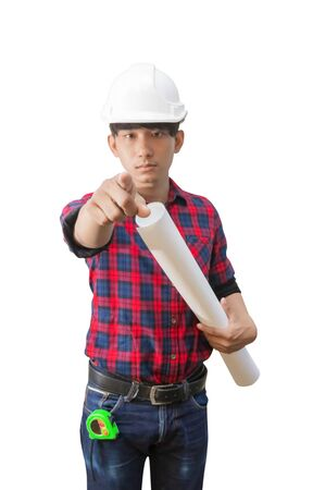 Engineer finger point with holding rolled blueprints inspect construction and wear white safety helmet plastic on white background