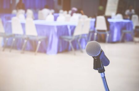microphone wireless on a stand in interior meeting room seminar empty conference background: Select focus with shallow depth of field.