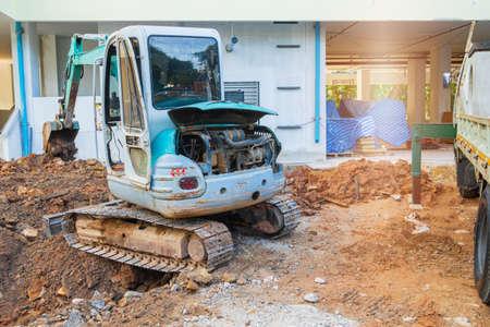 small excavator working excavation site construction