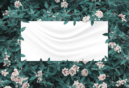 green leaves and flowers above crumpled fabric background