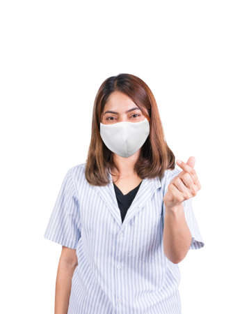 woman showing mini heart sign and wearing fabric mask safety Covid-19 or coronavirus on white background