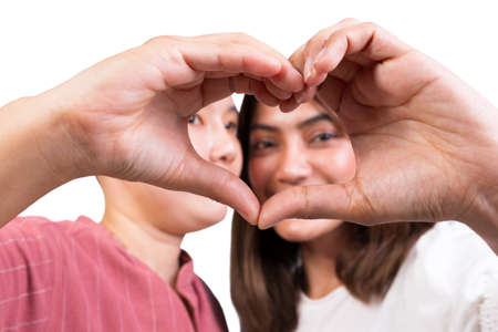 woman and tomboy romantic happy  in love gesturing heart with finger on white background