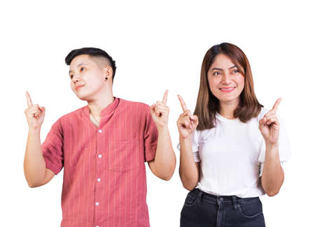 woman and tomboy pointing finger up happy couple on white background