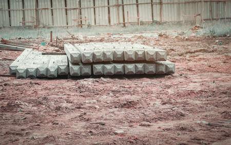 pile concrete pillars on ground in construction site Archivio Fotografico