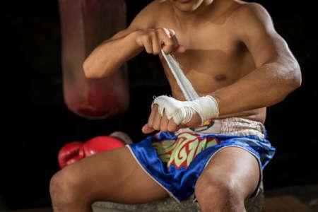 wrist strap: Man boxer wearing white strap on wrist