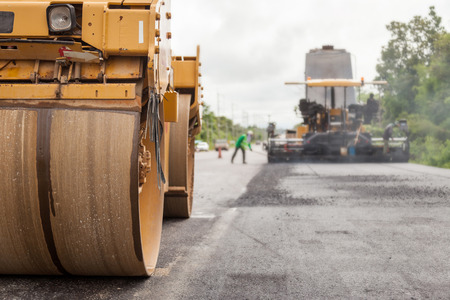 roller compactor: Road construction works with roller compactor machine and asphalt finisher Stock Photo
