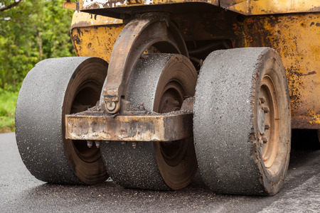 blacktopping: Road construction works with roller compactor machine and asphalt finisher Stock Photo