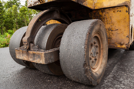 compactor: Road construction works with roller compactor machine and asphalt finisher Stock Photo