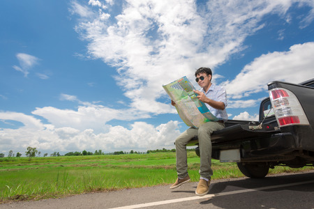 planned: He planned to travel on the rear tailgate, Thailand Stock Photo