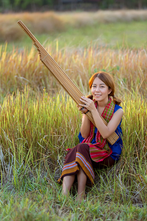 thai musical instrument: Beautiful Woman reed organ played by people of northeastern Thailand, Thai instruments