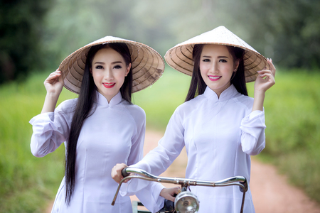 Beautiful woman with Vietnam culture traditional ,vintage style,Hoi an Vietnam Stock Photo