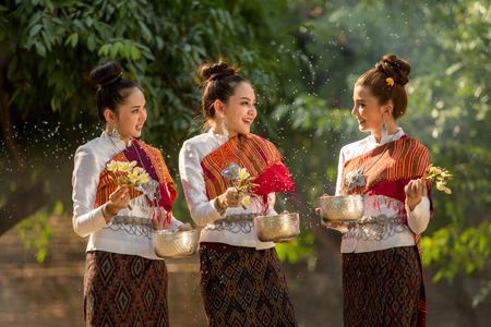 Thai girls splashing water during festival Songkran festival