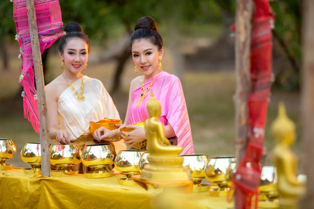 Asian woman like to make merit in thailand