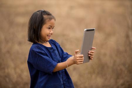 disadvantaged: Asian girls happily surf